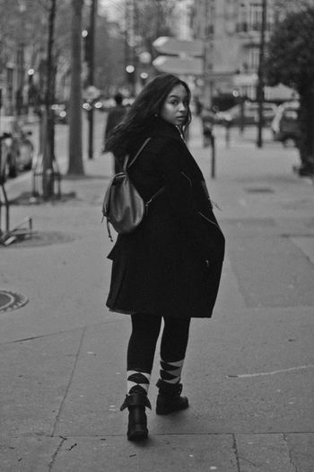 In Paris France Paris Adult Black And White Building Exterior City Day Europe Focus On Foreground Full Length Lifestyles Nature One Person Outdoors People Real People Standing Street Street Photography Tree Walking Warm Clothing Women Young Adult Young Women