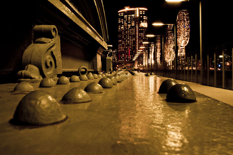 Architecture Illuminated Built Structure Night Building Exterior No People City Building Bridge Transportation Bridge - Man Made Structure Art And Craft Reflection Large Group Of Objects In A Row Connection Selective Focus Nature Surface Level