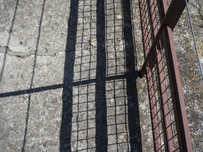 High angle view of fence against wall