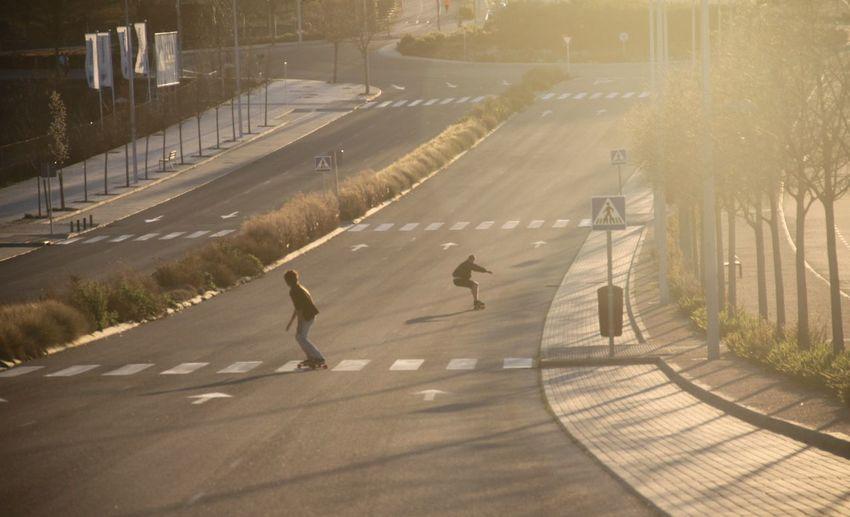 People skating on road