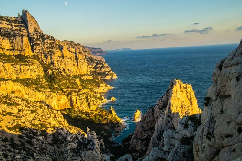marseille,calanque,bouche du rhone, france Sea Rock Water Scenics - Nature Sky Beauty In Nature Rock Formation Rock - Object Tranquil Scene Tranquility Solid Nature Cliff Horizon Over Water Horizon Mountain Land Non-urban Scene Idyllic No People Outdoors Formation Eroded Rocky Coastline