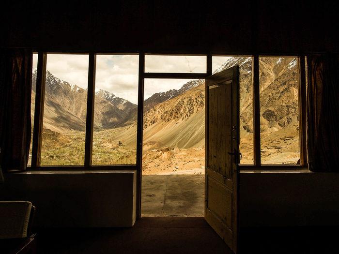 Mountains seen through open door