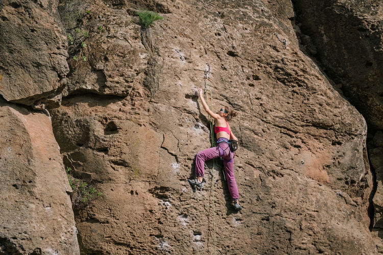 Climbing in Arico / Tenerife Adult Adults Only Adventure Cliff Climbing Day Extreme Sport Extreme Sports Full Length Hanging Low Angle View Mountain Mountain Range Mountains Nature One Person One Woman Only Outdoors RISK Rock Rock - Object Rock Climbing Rope Sport Strength