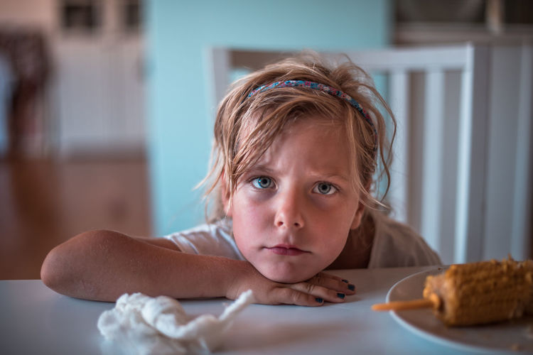 Close-Up Portrait Of Girl At Home