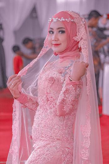 Portrait of bride standing in wedding ceremony
