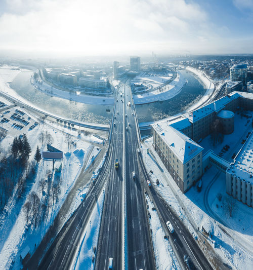 Vilnius, Lithuania, street traffic, bridge over river Neris, aerial panorama Aerial View Aerial Vilnius City Capital Cities  Capital Lithuania Lietuva River Neris Traffic Road Street Highway Bridge Transportation Cityscape Travel View Cold Temperature Cold Snow Ice Freeway Motorway Junction Intersection Winter High Angle View Architecture Multiple Lane Highway