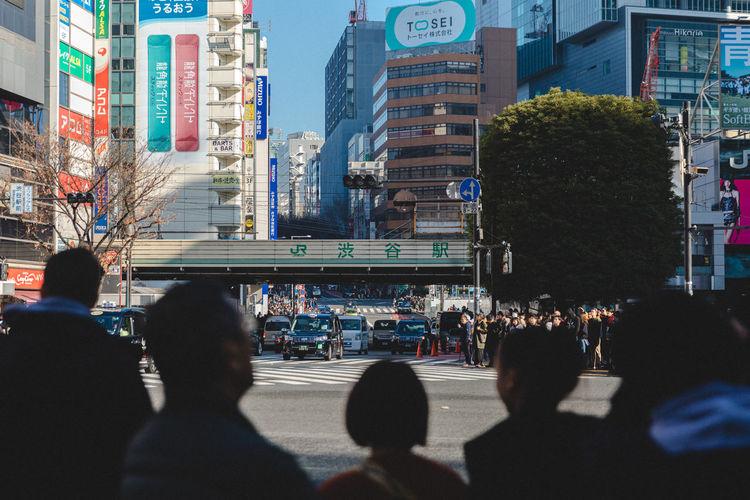 People on city street amidst buildings