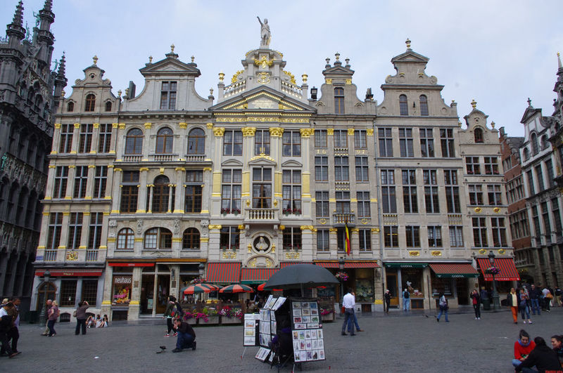 Grand Place Brussels - street stall Brussels Europe Capital Cities  Grand Place Grote Markt Grand Place Bruxelles Façade Building Exterior Architecture Built Structure City Group Of People Street Sky Building Real People Façade Travel Destinations Travel People Men Nature Day Women City Life Crowd Outdoors
