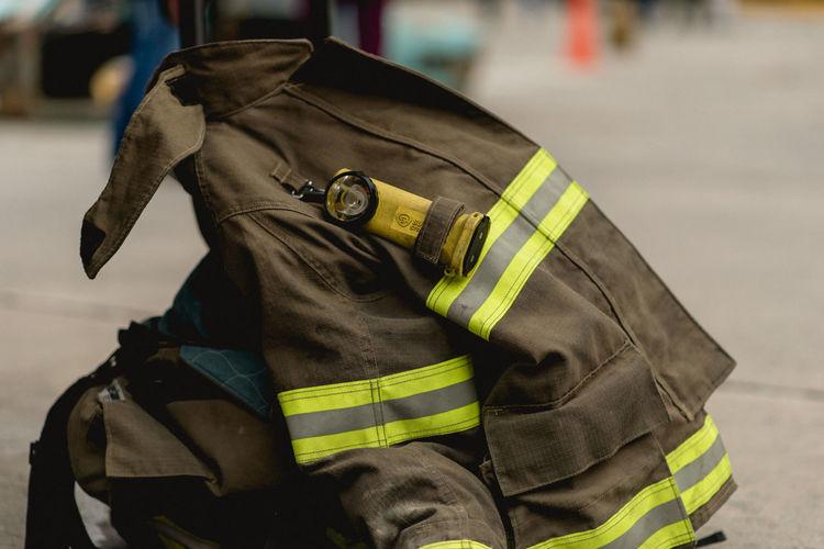 Close-up of firefighter uniform on sidewalk