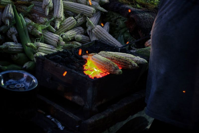 High angle view of corns being grilled on barbecue grill