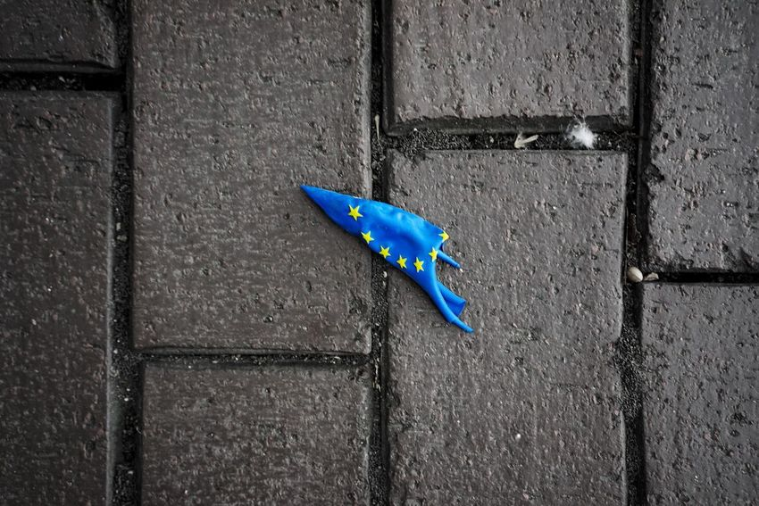 Pavement Popped Balloon Brexit Blue No People Day Wall - Building Feature Close-up Textured  Footpath Outdoors Pattern High Angle View Simplicity Single Object