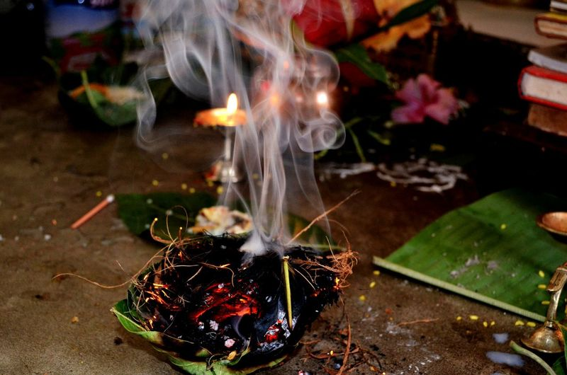 Close-Up Of Burning Leaf Incense At Temple