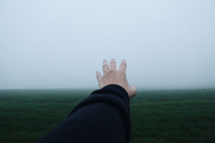 Person standing on grassy field