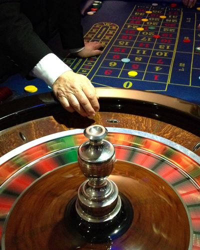 Gambling Human Hand Casino Indoors  One Person Men Human Body Part Skill  Luck Playing Chance Real People Close-up Day People Adult Adults Only