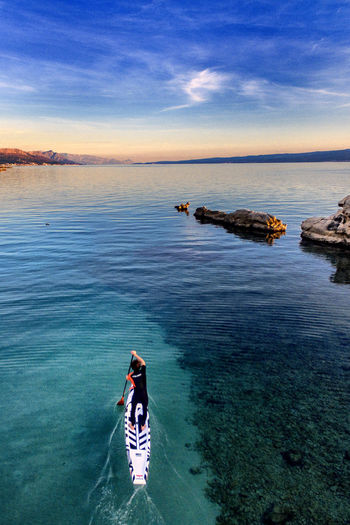 Stand Up Paddling on the Ocean Water Sea Leisure Activity Real People Nature One Person Outdoors Sup Stand Up Paddle Stand Up Paddling Board Ocean Aerial View Man Paddling Sport Active Surf Board