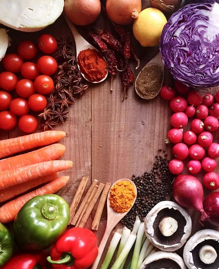 High angle view of spices and vegetables on table