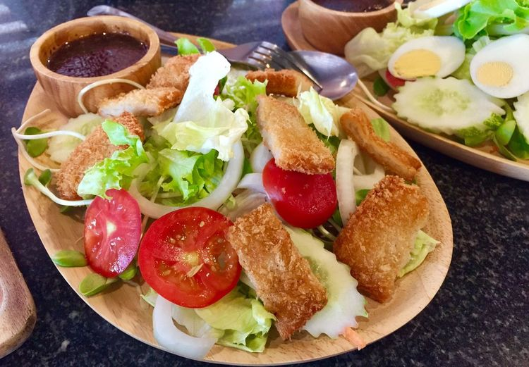 Deep fried fish salad Food And Drink Food Healthy Eating Ready-to-eat Freshness Vegetable Plate Tomato Serving Size Indoors  Still Life Wellbeing High Angle View Bread Meal Fruit No People Table Salad Close-up