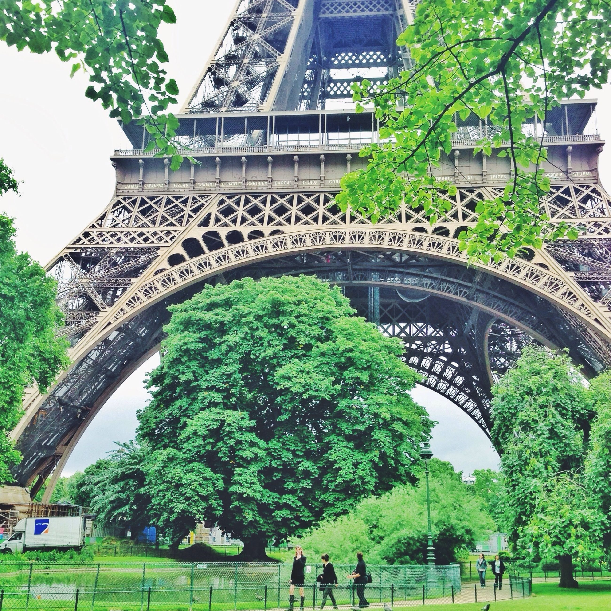 architecture, built structure, tree, building exterior, green color, arch, city, travel destinations, incidental people, growth, connection, grass, famous place, bridge - man made structure, plant, travel, park - man made space, day, capital cities, formal garden