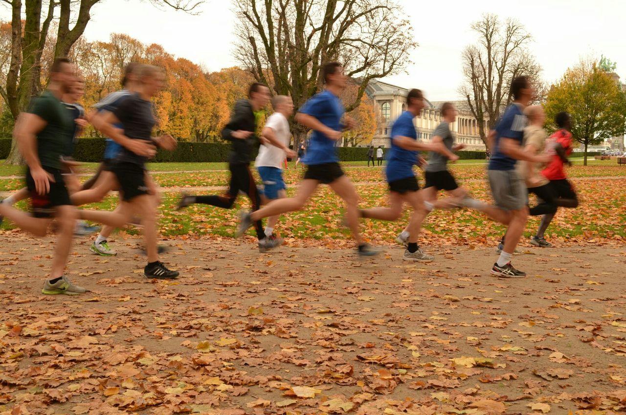 PEOPLE RUNNING ON FIELD