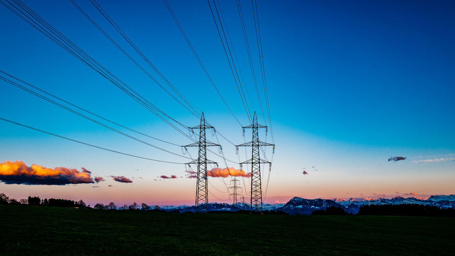 Beauty In Nature Blue Clear Sky Copy Space Electricity  Electricity Pylon Field Gormund Grass Idyllic Kapelle Landscape Nature Non-urban Scene Outdoors Power Line  Scenics Sky Sunset Tranquil Scene Tranquility Water
