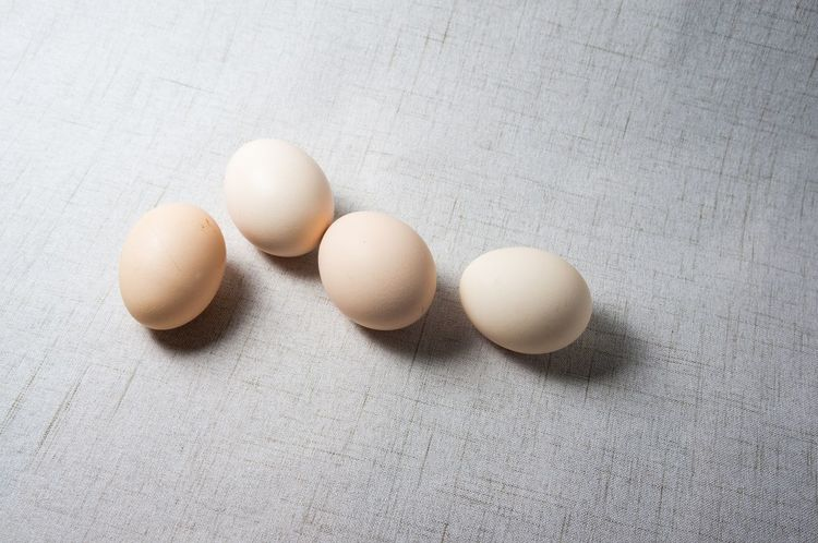 Egg Food And Drink High Angle View Healthy Eating Raw Food Food Eggshell Indoors  Protein Freshness Preparation  No People Egg Carton Egg Yolk Ingredient Boiled Egg Table Brown Cracked Fragility