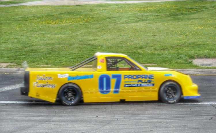 New colors and sponsors for my buddies sport truck.... Racing Pickuptruck 07 Taking Photos Things That Go Fast Seekonkspeedway Racecar Mode Of Transportation Motor Vehicle No People Single Object Land Vehicle Yellow Day Motion Outdoors