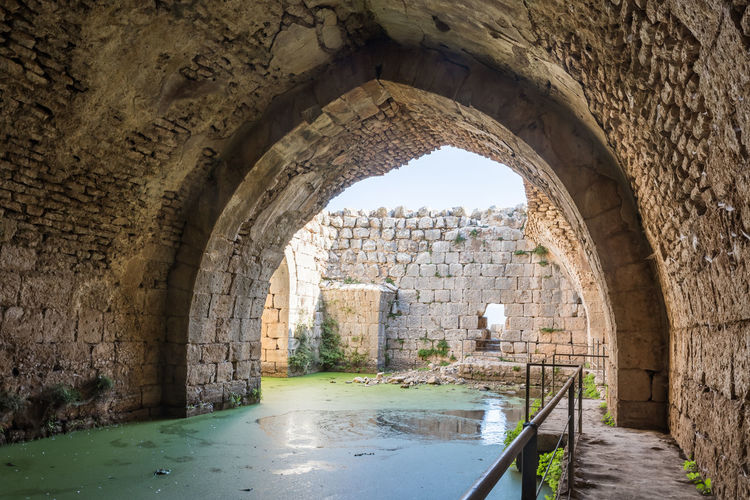 Flooded inner tier in Nimrod Fortress located in Upper Galilee in northern Israel on the border with Lebanon. Nimrod Fortress History Heritage Castle Fort Israel Saladin Beybars Crusaders Ayubids Mamluks Assassins Tower Travel Destinations Wall Stone Material National Park Tourism Hill Old Ancient Architecture Medieval Landmark Ruin Protection