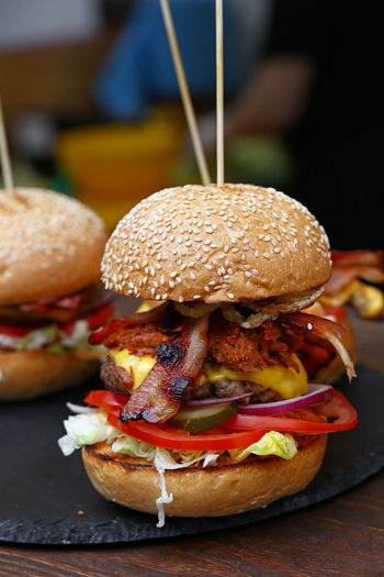 Close-up of burgers on table