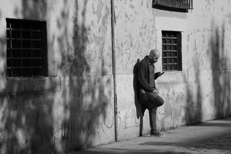 Hello World Streetphotography Man And Phone Sunbath ShadowOnTheWall