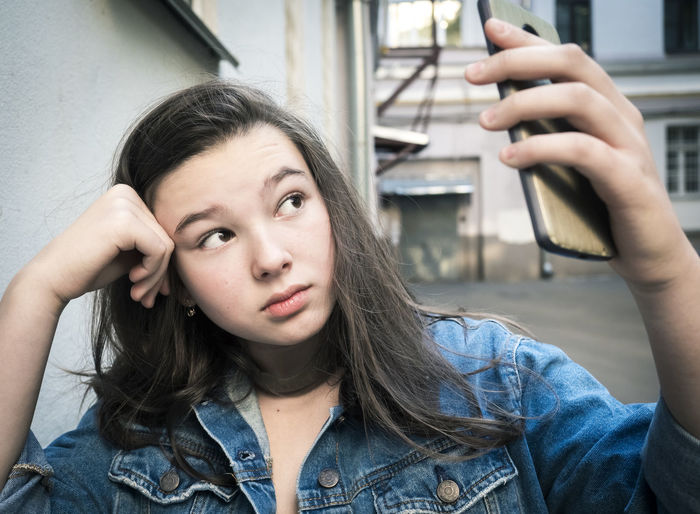 Close-Up Of Girl Taking Selfie Through Mobile Phone