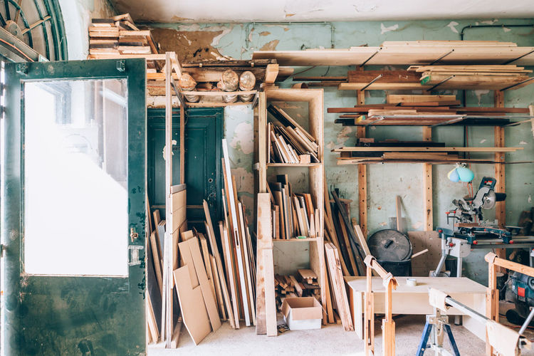 Vintage woodwork workshop full of wooden pieces and planks of wood