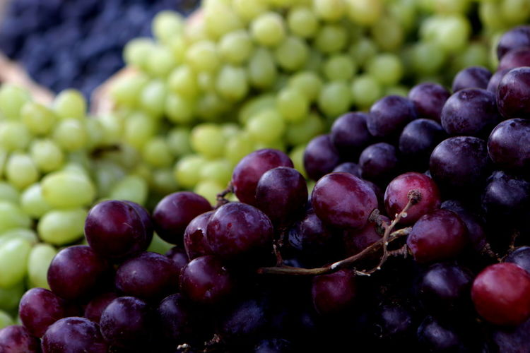 Close-Up Of Grapes In Market For Sale
