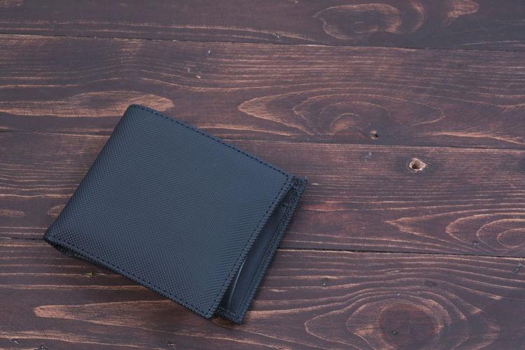 High angle view of wallet on hardwood floor