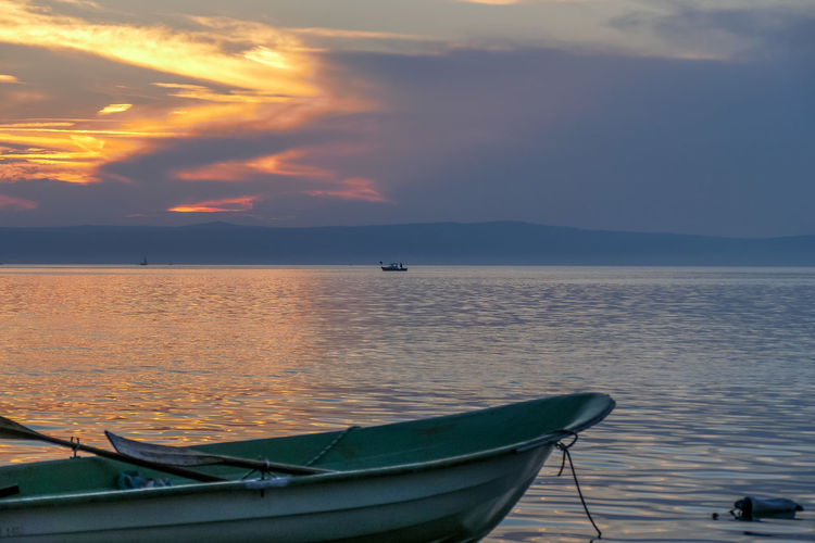Nautical Vessel Water Mode Of Transportation Transportation Sky Sea Sunset Scenics - Nature Beauty In Nature Cloud - Sky Moored Tranquility No People Nature Tranquil Scene Idyllic Horizon Over Water Travel Horizon Outdoors Rowboat Anchored