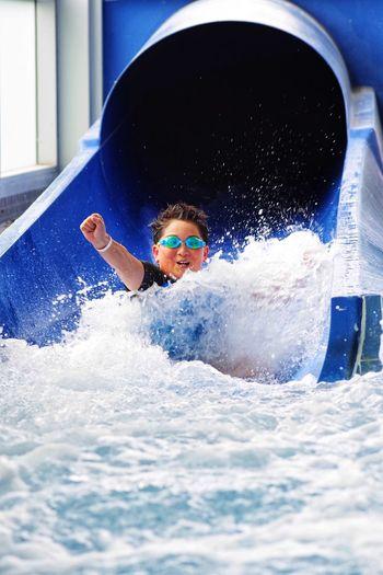 Boy enjoying water slide