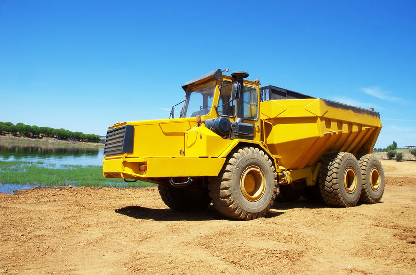 yellow Dumper industrial truck Industrial Truck Land Vehicle Machinery Mode Of Transportation Transportation Truck Wheel Yellow Yellow Dumper