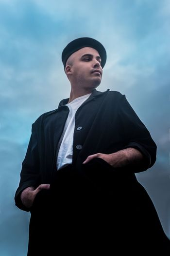 Jimmy Nevis One Person Low Angle View Looking Away Sky Clothing Real People Young Adult Three Quarter Length Standing Lifestyles Adult Young Men Cloud - Sky Men Front View Looking Males  Waist Up
