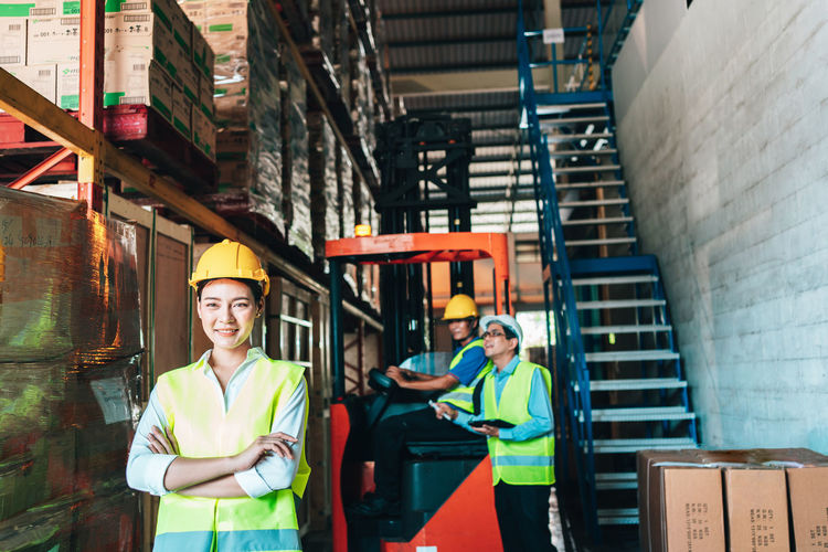 Portrait of people working in warehouse