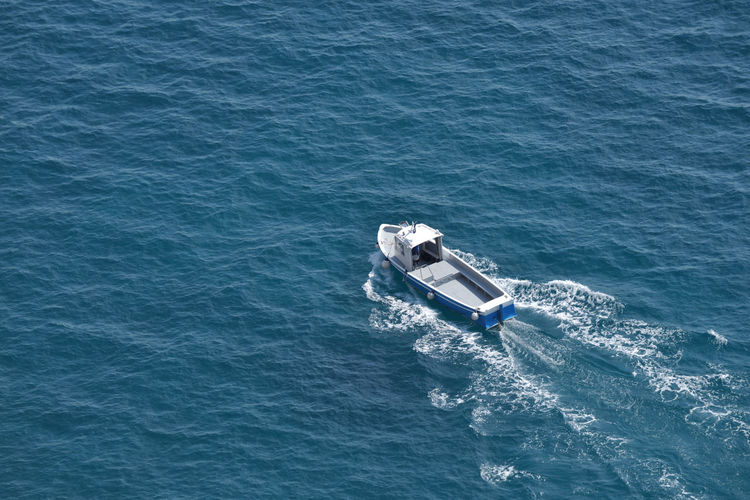 High angle view of boat moving in sea