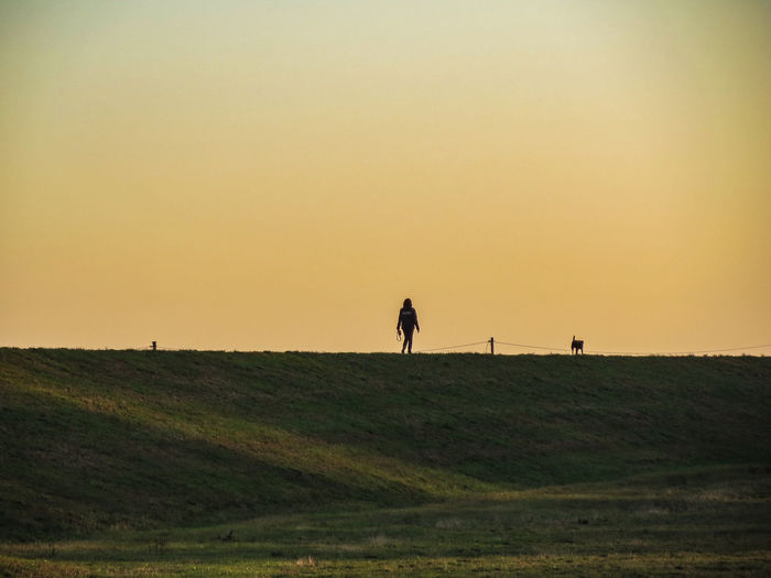 Einsam auf dem Deich Dog Autumn November Sundown Silhouette Photography Silhouettes EyeEm Selects Woman Deich  Sand Dune Sunset Sky Landscape Grass Farmland Cultivated Land Agricultural Field Following Fall Dog Lead