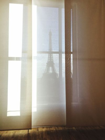 Eiffel Tower Seen Through Window