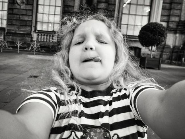 Selfie time! Walking around Dresden in nice sunny weather, you will see many people hanging their nice precious phones on nice extending selfie sticks, posing for nice smiling selfies in front of nice old-fashioned backgrounds. We thought we don't need any of this fancy stuff. :-) - MAinLoveWithFreedom and Little Girl Fooling Around Having Fun Fun #funnyfaces Selfie Selfies Selfie Time Worlds Worst Selfies Monochrome Black And White Black & White Bnw Bnw_collection Bnw_captures Bnw_life Bnw Photography Children Children Photography Childhood Different Perspective How I Feel At Times How I See People How I See The World VanessArt - 17.08.2016