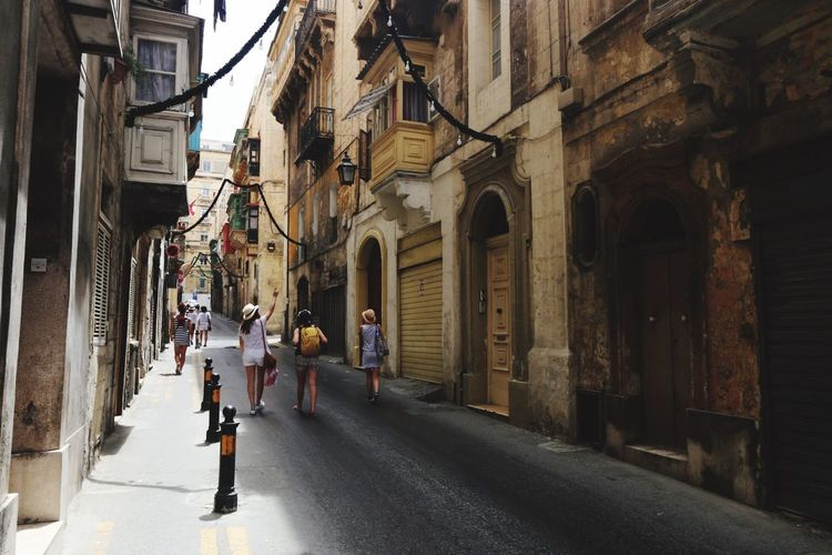 Chilling Walking The Way Forward Walking Around The City  On The Road Holydays Lifestyles Travel Destinations Malta City Street Old Buildings History Paved Road Architecture