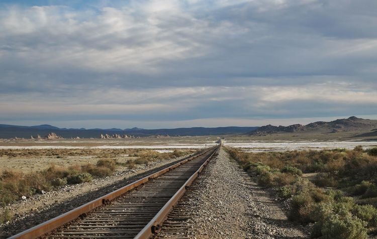 Lost In The Landscape Beauty In Nature Cloud - Sky Day Diminishing Perspective Landscape Nature No People Outdoors Rail Transportation Railroad Track Railway Track Scenics Sky The Way Forward Transportation Trona Pinnacles An Eye For Travel