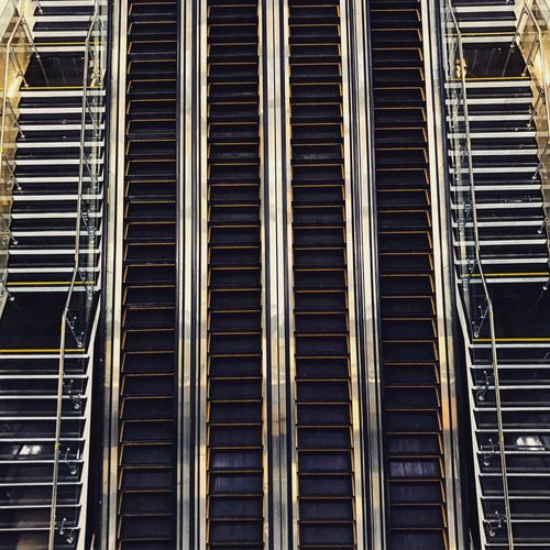 Directly above shot of escalators in building