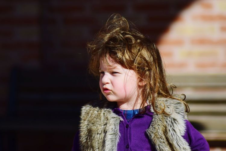 Close-up of girl looking away in warm clothes