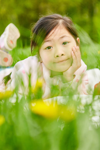 Portrait of cute girl with flowers