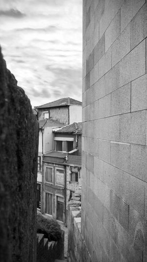BeW City Cityscape Oporto, Portugal Architecture Black And White Brick Brick Wall Building Building Exterior Built Structure City Cloud - Sky Day House Low Angle View Monochrome Nature No People Old Outdoors Residential District Sky Stone Wall Wall Wall - Building Feature Window