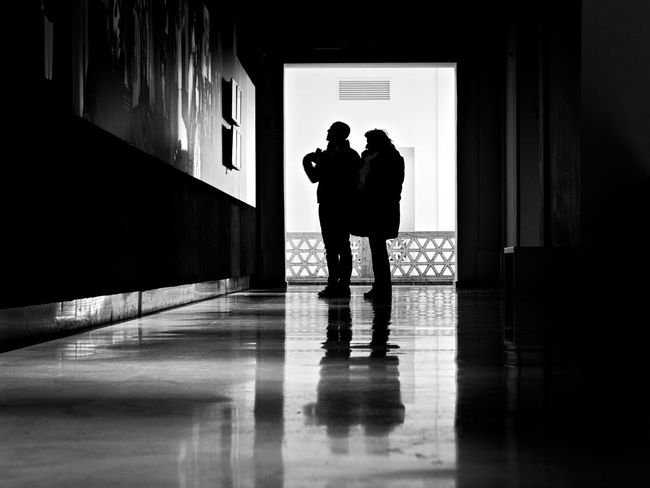 Real People Flooring Indoors  Standing Men Two People Lifestyles Silhouette People Full Length Leisure Activity Architecture Building Adult Women Reflection Built Structure Dark Togetherness