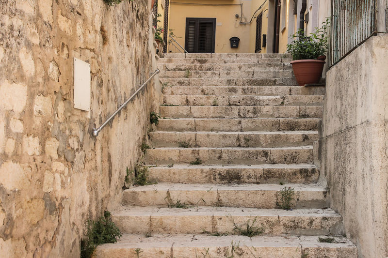 Low angle view of steps amidst buildings